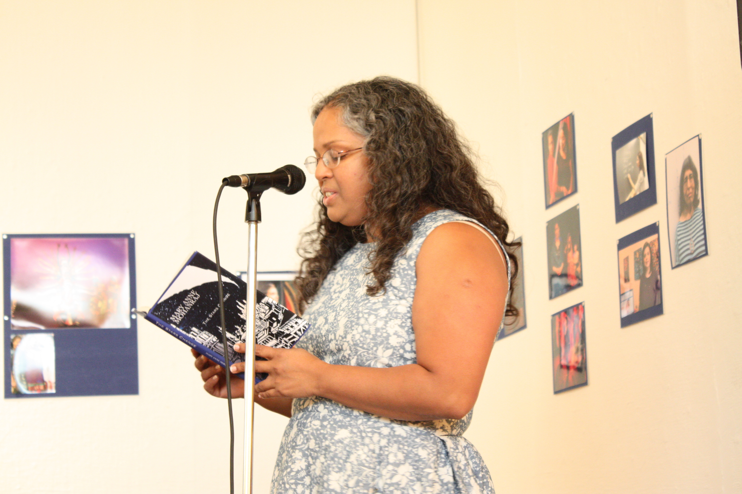 "Mary Anne Mohanraj, festival director, reading from ""The Stars Change"" at the opening night reception"