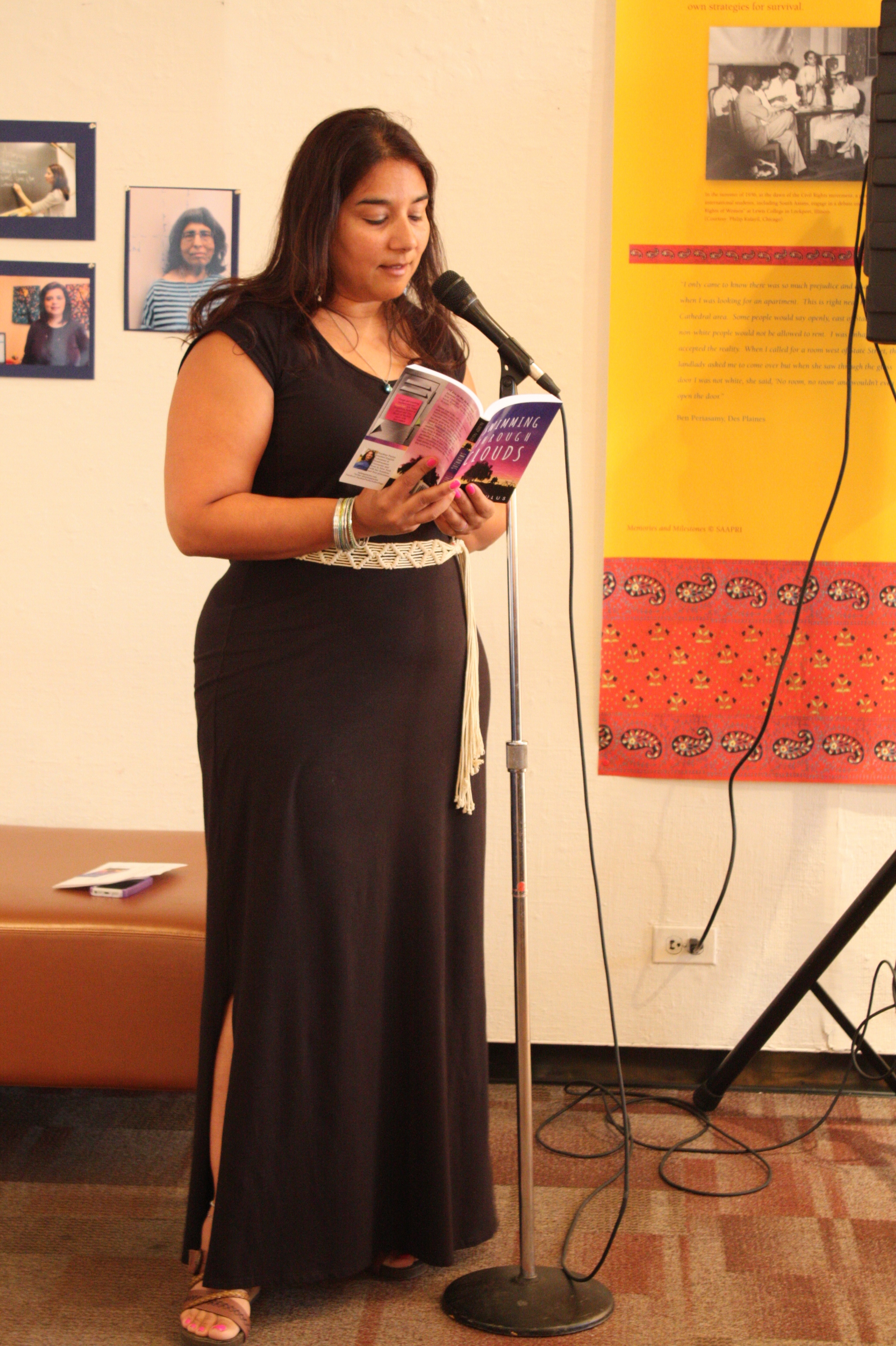 """Rajdeep Paulus reading from """"Swimming Through Clouds"""" at the opening night reception"""