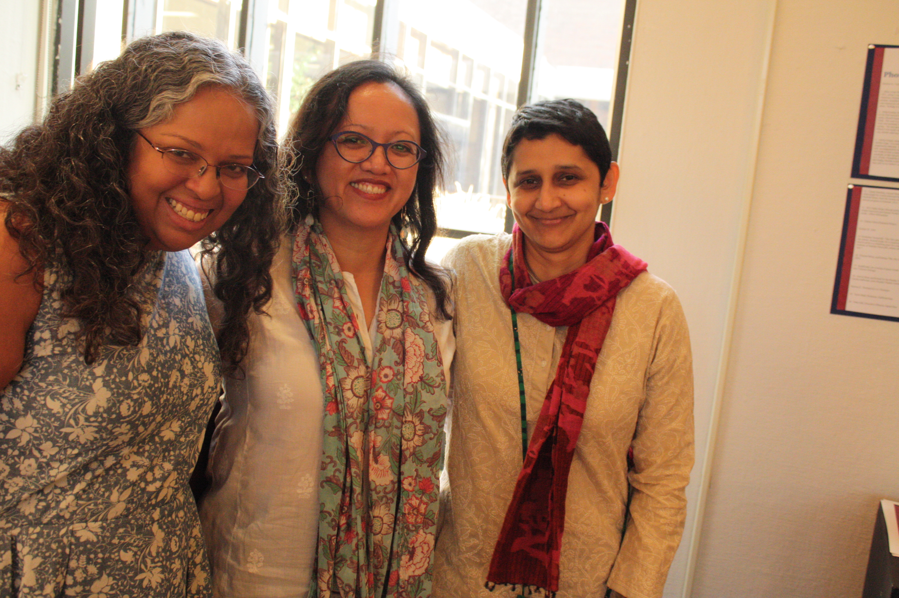 (left to right) Mary Anne Mohanraj, festival director, Anna Guevarra, professor of Asian American studies, and Gayatri Reddy, professor of Asian studies, at the opening night reception