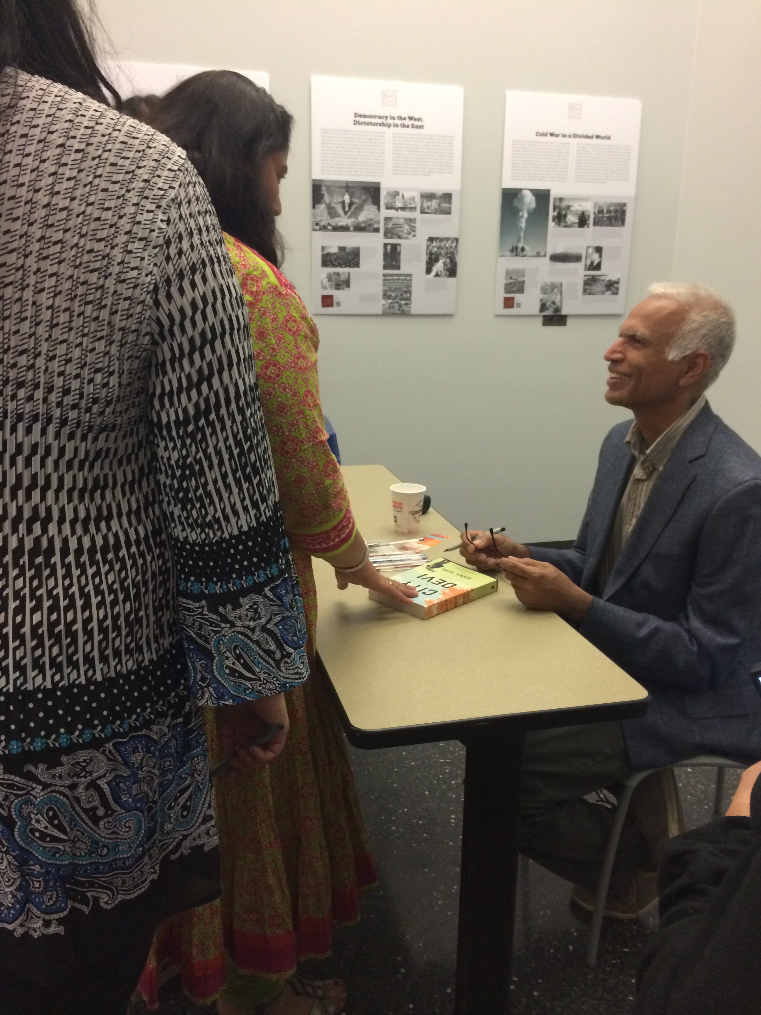 Manil Suri signing books after one of his speeches