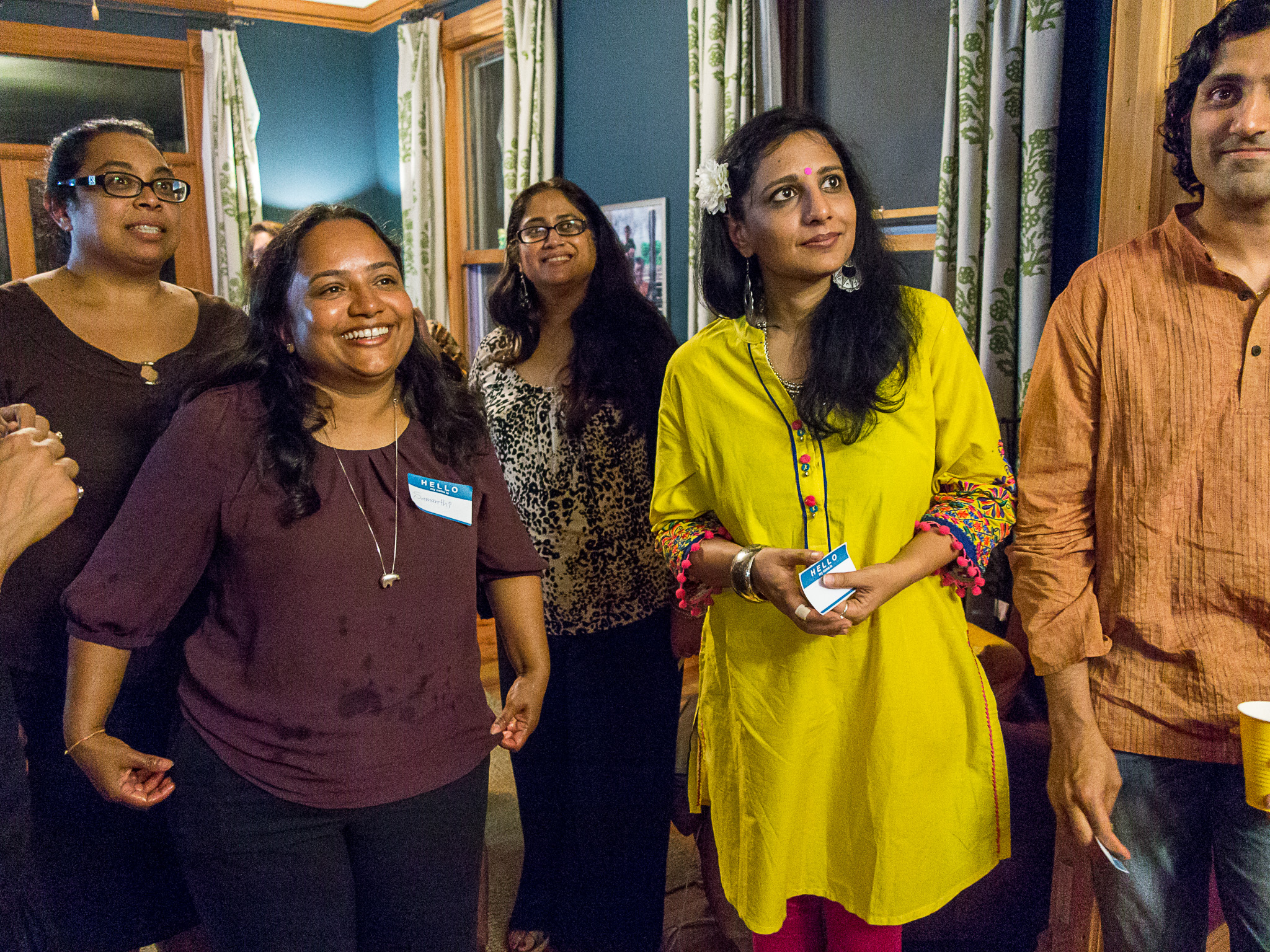 Festival volunteers Roshani Anandappa and Samanthi Hewakapuge, with panelists Shikha Malaviya, Neha Misra, and Arvind Venugopal at Thursday night panelist dinner